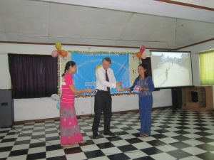 Presenting community health awards at the Campion Institute, Rangoon