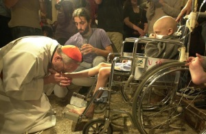 Pope Francis as Archbishop of Buenos Aires - places himself at the service of a disabled child