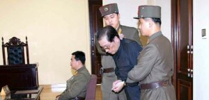 Chang Song Thaek is dragged into the court by uniformed personnel before being executed in the latest North Korean purge
