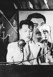 Kim Il Sung in front of a picture of Joseph Stalin