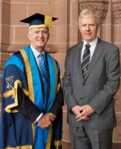 "The Royal British Legion received a Corporate Award from Liverpool John Moores University on Tuesday 15 July 2014 for services to the Armed Forces. The citation was presented by Professor the Lord Alton of Liverpool. The Royal British Legion helps the whole Armed Forces community through welfare, companionship and representation as well as being the Nation's custodian of Remembrance. The Legion recently opened a brand new Advice and Information Centre in the heart of Liverpool's city centre for Service personnel and veterans to 'Pop In' for support and advice. This was the first of 16 brand new centres opened in major cities across the UK, as part of the Legion's biggest ever transformation to bring its work closer to the Armed Forces community. During the Centenary of Britain entering the First World War, the Legion is involved in a number of commemorative events. Vice Admiral Peter Wilkinson (pictured with Vice Chancellor Professor Nigel Weatherill) accepted the Corporate Award. He commented: ""The Royal British Legion was funded after World War One and it is poignant and appropriate that the University is awarding this award 100 years on. ""I am proud to accept this award on behalf of all those who have worked so hard to make the charity the success it is today."""