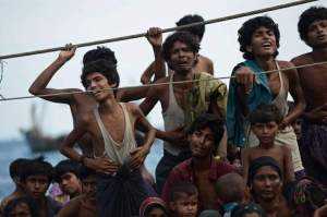 Rohingya migrants stand and sit on a boat drifting in Thai waters off the southern island of Koh Lipe in the Andaman sea on May 14, 2015.  The boat crammed with scores of Rohingya migrants -- including many young children -- was found drifting in Thai waters on May 14, according to an AFP reporter at the scene, with passengers saying several people had died over the last few days.     AFP PHOTO / Christophe ARCHAMBAULTCHRISTOPHE ARCHAMBAULT/AFP/Getty Images