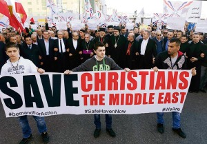 Assyrians hold banners as they march in solidarity with the Assyrians abducted by Islamic State fighters in Syria earlier this week, in Beirut