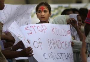 a-pakistani-christian-girl-stands-with-a-cross-on-her-forehead-while