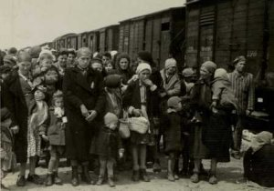 In this photo provided by Yad Vashem Photo Archives, Jewish women and children deported from Hungary, separated from the men, line up for selection on the selection platform at Auschwitz camp in Birkenau, Poland in May 1944. (AP Photo/Yad Vashem Photo Archives) ** NO SALES **